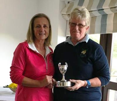 Wrangaton Captain Nessa Mabelle with Mel Winter Bovey Tracey Captain receiving Runners Up Trophy